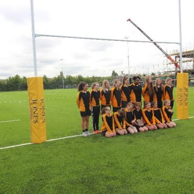 Tom Varndell meets school pupils at the opening of the Lockleaze artificial pitch